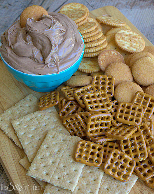 Creamy Nutella Peanut Butter Dip, a sinfully sweet dip to serve as an appetizer or dessert! - ThisSillyGirlsLife.com