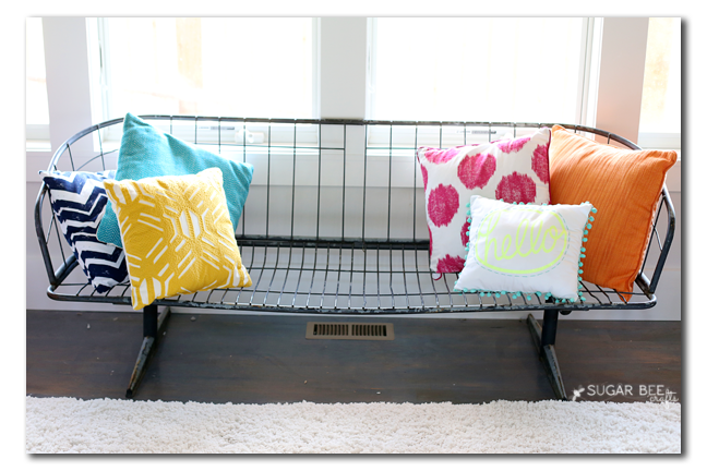 wire metal bench with pillows
