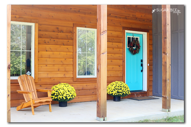 cedar front porch pop of turquoise