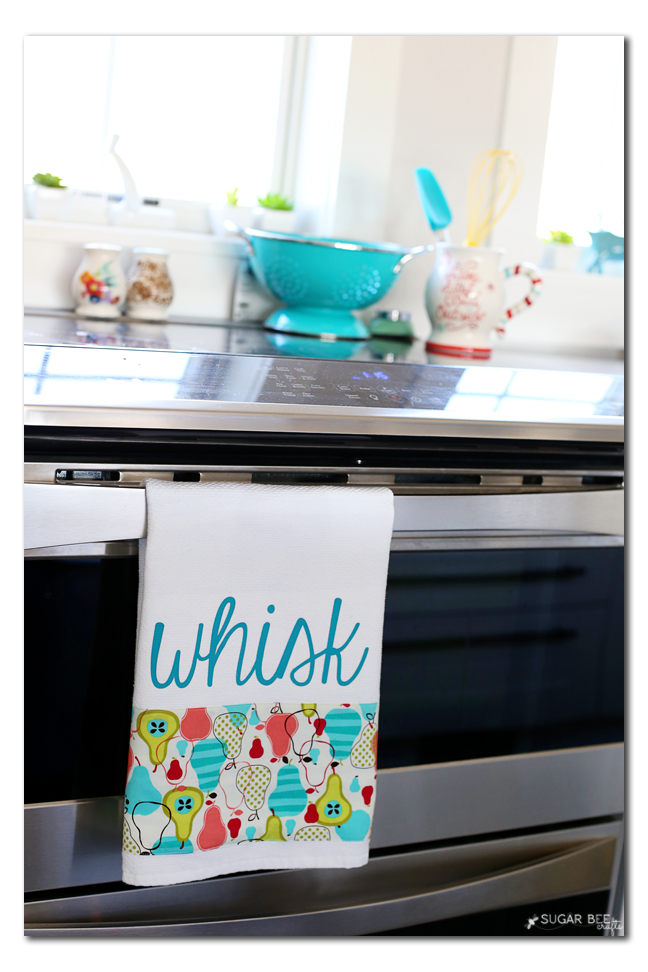 how to make a diy kitchen towel with fabric and vinyl