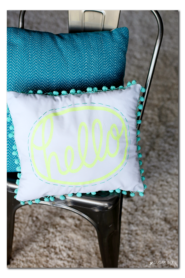 how-to-make-a-pom-pom-hello-pillow