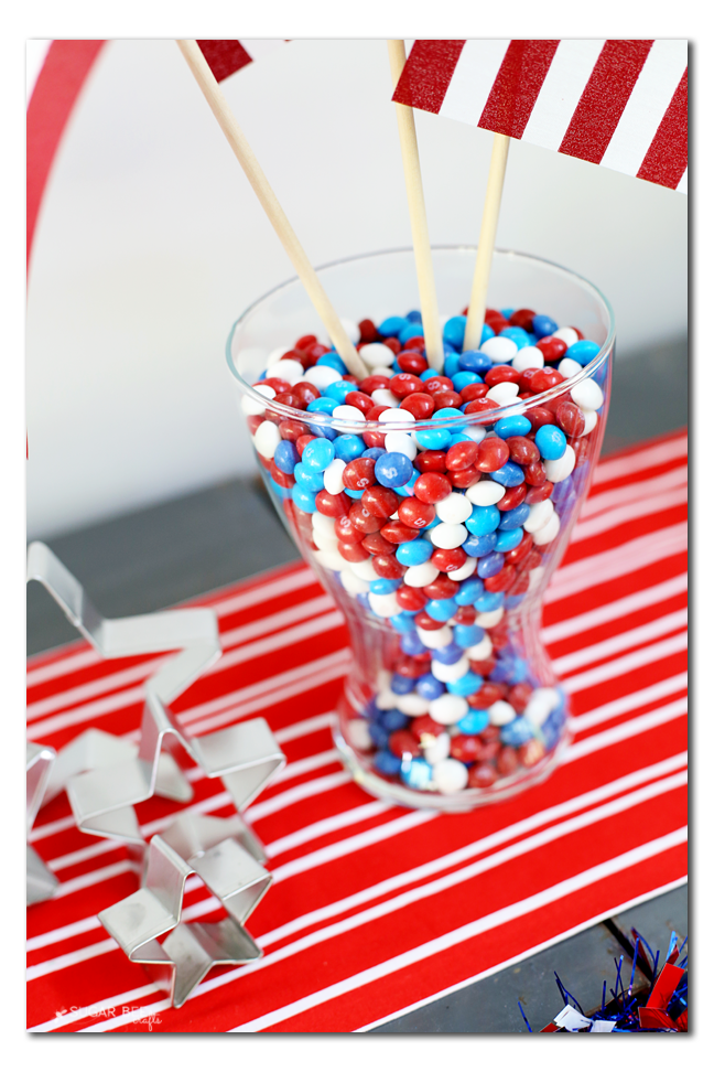 skittles in a vase with flags party decor idea