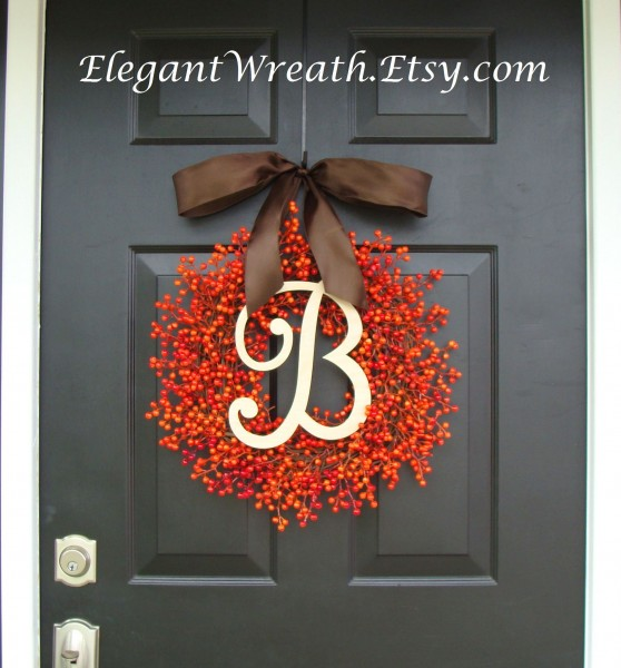 orange-berry-wreath-with-monogram-vi-558x600